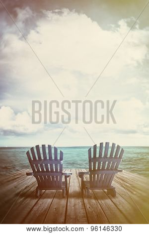 Blue adirondack chairs on dock with vintage textures and feel