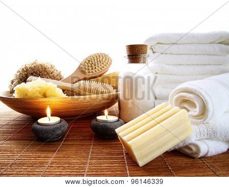 Spa accessories with lit candles and towels