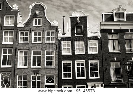 Typical Dutch house facades in sepia