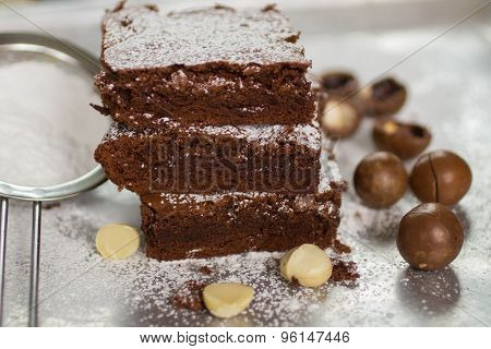 Brownie. Chocolate cakes with  macadamia