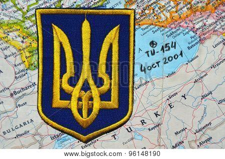 Ukrainian military chevron.Map of Black Sea as background.With site of crush Tu-154M at 4 october 2001.Flight SBI1812 Tel-Aviv Novosibirsk downed by Ukrainian S-200 missle.July14,2015 in Kiev,Ukraine