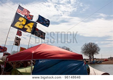 Fans Fly Nascar Flags While Camping Outside Race Track