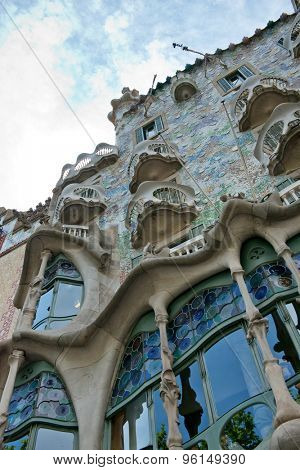 BARCELONA - MAY 01: The facade of the house Casa Battlo (also known as the house of bones) designed by Antoni Gaudia­ in his famous expressionistic style on May 01, 2015 Barcelona, Spain