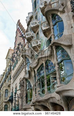 BARCELONA - MAY 01: The facade of the house Casa Battlo (also known as the house of bones) designed by Antoni Gaudia in his famous expressionistic style on May 01, 2015 Barcelona, Spain