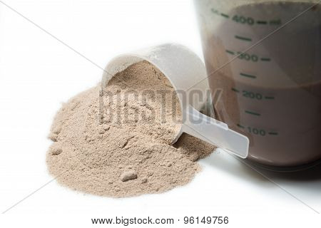 Chocolate Protein Shake And A Scoop Of  Protein Powder  Poured On White Background Isolated