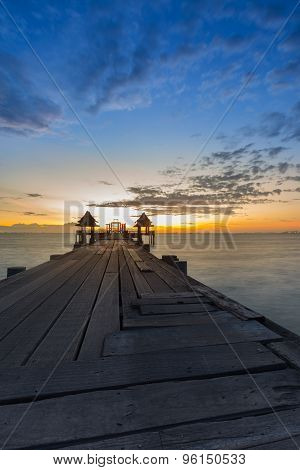 Landscape of Wooded bridge in the port during sunset