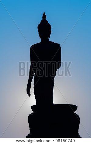 Buddha silhouette statue standing