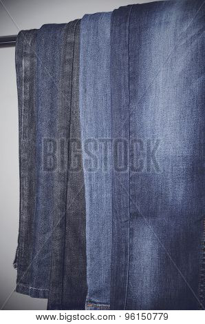Jeans Hanging Vertically On A Hanger. Vertical