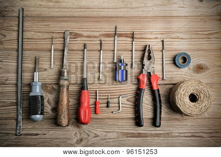 Set Of Work Tools On A Wooden Table In A Row. Horizontal