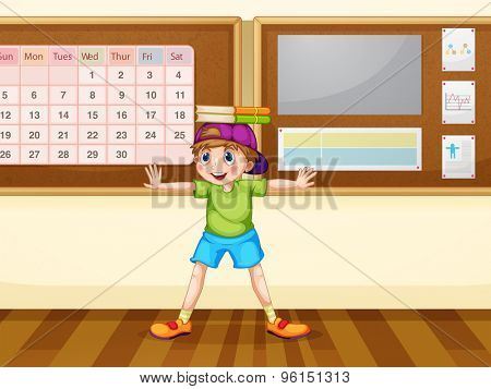 Boy with books on his head in the classroom