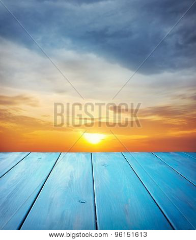 Wooden Table And Sky Background