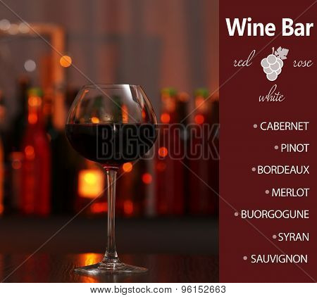 Glass of red wine in bar on blurred background