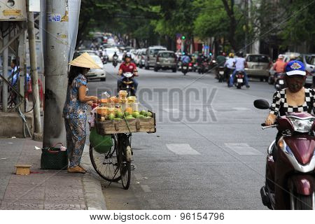 A Vietnamese Female Fruit Seller In The Old Town Of Ho Chi Minh
