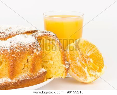 Orange cake with orange juice and orange's slice.