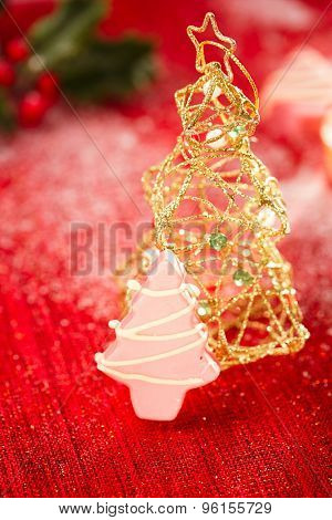 pink christmas tree homemade sweets with glitter christmas tree decoration on golden red background