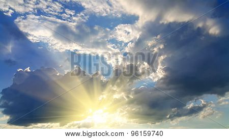 Sky Background With Dark Clouds And Sunlight