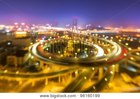 illuminated road intersection and defocus traffic trails