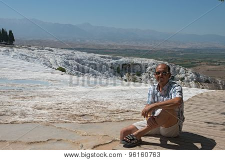 Man On Background Of Travertine Pools In Pamukkale, Turkey.