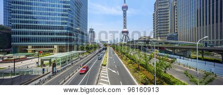 cityscape of shanghai and traffic on road