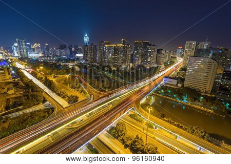 illuminated skyline and road intersection