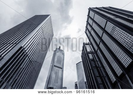 low angle view of modern skyscraper exterior and sky