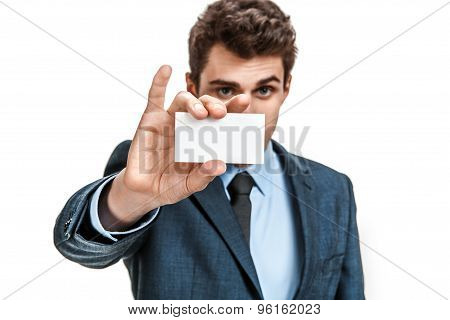 Business Man In Suit Showing His Blank Business Card Ready For Your Text