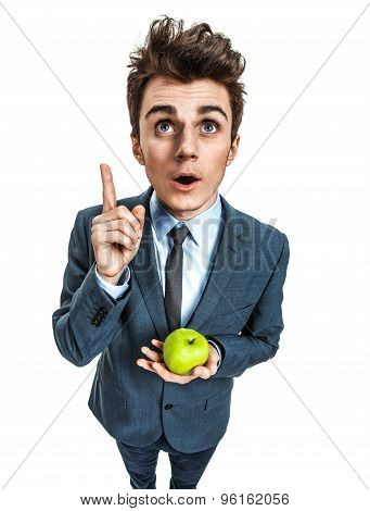 Young Adult Holding An Apple In His Hand And Finger Pointing Up, Healthy Eating Concept