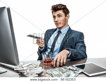 Young Manager Sitting At Desk In Office And Thinking About His Investment Plan