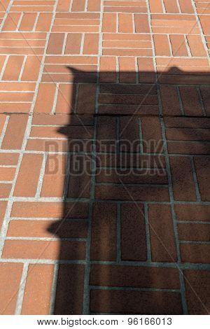 Shadow On Bricks