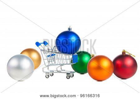 Shopping cart and christmas balls.
