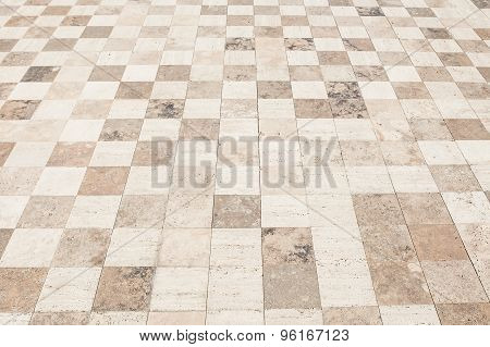 Rough textured stone tiles, exterior walkway, perspective view. Large square slab patterned flooring