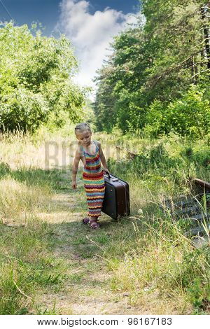 Little Girl With A Suitcase At The Railway