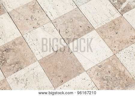 Close up of a large stone tile floor into the distance