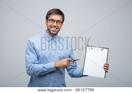 Attractive young male worker is presenting his job