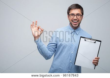 Cheerful young man is working with happiness