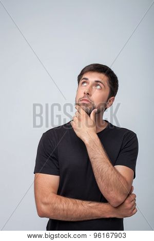 Beautiful young man is planning something interesting
