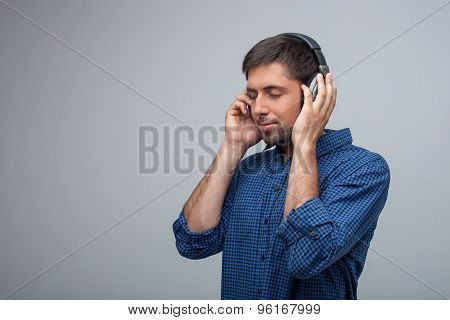 Attractive young man is relaxing with earphones