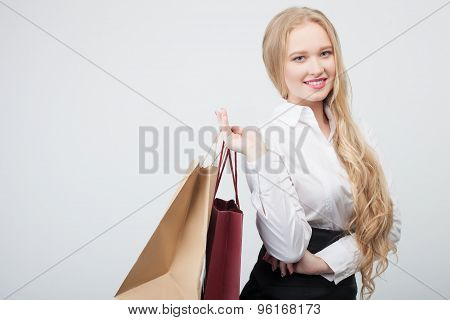 Cheerful young woman is buying new clothing