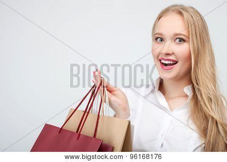 Pretty young female shopaholic is going shopping