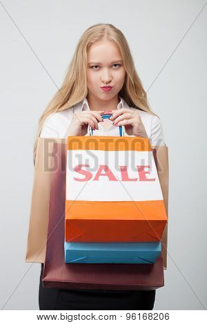 Attractive young girl is frustrated after shopping