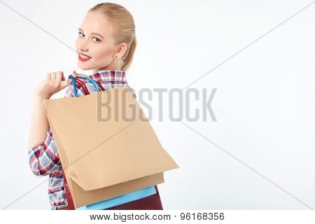 Cheerful young girl is purchasing in boutique