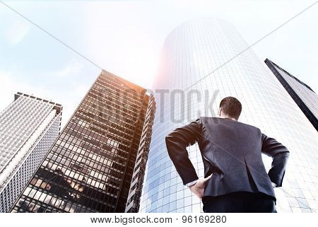 Businessman Looking On Skyscraper