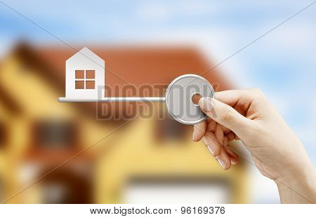 Hand Holding Key House