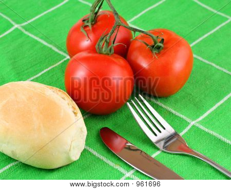 Red Tomatoes On Green Cloth