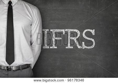 International financial reporting standards on black blackboard