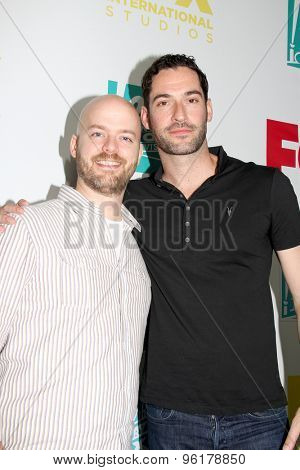 SAN DIEGO, CA - JULY 10: Tom Ellis and guest arrive at the 20th Century Fox/FX Comic Con party at the Andez hotel on July 10, 2015 in San Diego, CA.
