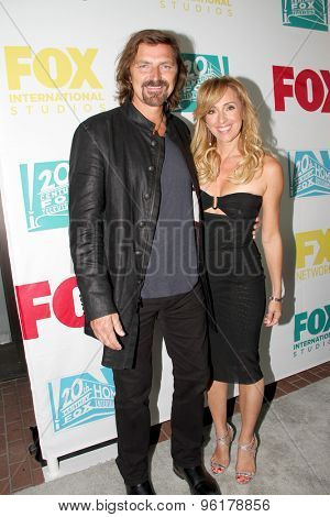 SAN DIEGO, CA - JULY 10: Robin Atkin Downes and Michael Ann Young  arrive at the 20th Century Fox/FX Comic Con party at the Andez hotel on July 10, 2015 in San Diego, CA.