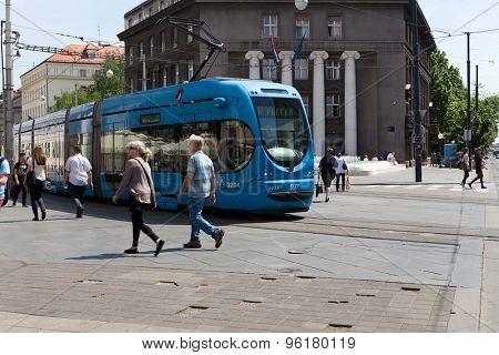 ZAGREB, CROATIA - MAY 13, 2015: Tram and people passing by through Draskoviceva street