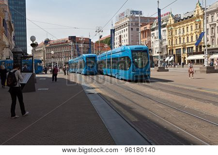 ZAGREB, CROATIA - MAY 13, 2015: Trams and people passing by through the Ban Jelacic Square