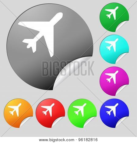 Airplane Icon Sign. Set Of Eight Multi Colored Round Buttons, Stickers. Vector